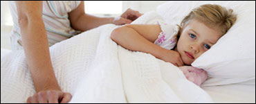 niña enferma en cama